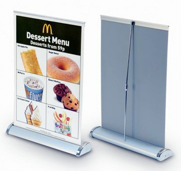 "<p align=""left""> Mini Rollup Standees are portable Pullup Display Stands for communicating promotional marketing messages. The Standee can be used as a table top for brand communication."